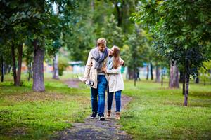 Amorous couple taking walk in natural environment