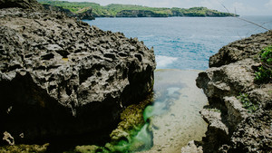 Angels Billabong, beautiful Cliff Formation with Yellow Pool, Bizarre Place, Nusa Penida Bali Indonesia