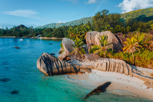 Anse Source D Argent beach, Seychelles. Aerial drone photo of unique tropical island landscape at warm sunset light