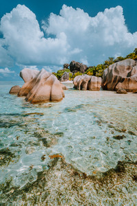 Anse Source d'Argent - Dreamlike, paradise beach with unique bizarre granite boulders, shallow lagoon water. La Digue island, Seychelles. Vertical shot