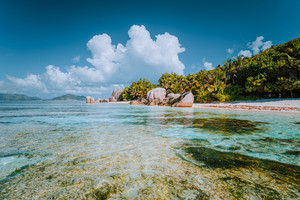 Anse Source d'Argent - Paradise beach with bizarre rocks, shallow lagoon water on La Digue island in Seychelles