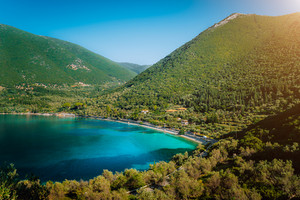 Antisamos beach on Kefalonia island, Greece. Crystal clear water, huge hills overgrown with cypresses, pine and olive trees. Stunning view of mediterranean coasline