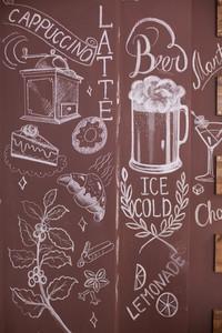 Artistic drawing on the walls of a vintage coffee shop. Beer draft. Croissant