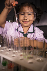 asian children in science examination laboratory