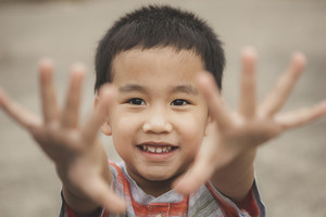 asian children playing with happiness face