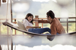 asian couples relaxing vacation time on cradle