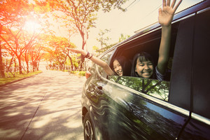 asian teenager sitting in passenger car with happiness emotion  ,family traveling theme