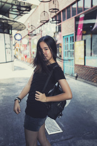 asian teenager with school backpack happiness emotion  traveling location