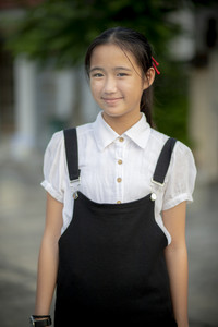asian teenager with smiling face standing outdoor