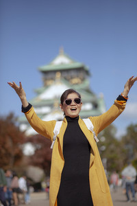 asian traveling woman happiness emotion in front of osaka castle one of most popular traveling destination in japan