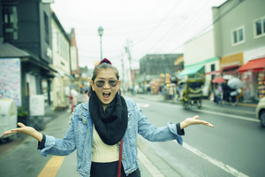 asian woman happiness emotion traveling in otaru town street hokkaido japan