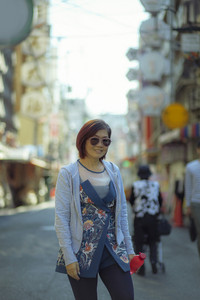 asian woman toothy smiling face standing in dotonbori street one of most popular traveling destination in  osaka japan