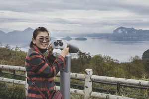 asian woman toothy smiling happiness face standing at surveillance camera of lake toy one of most popular traveling destination in hokkaido japan