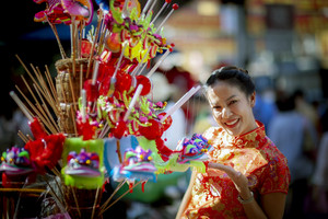 asian woman wearing chinese tradition clothes toothy smiling face in yaowarat chinatown bangkok thailand