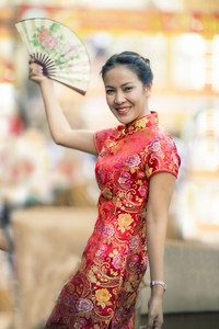asian woman wearing chinese woman tradition clothes toothy smiling face in yaowarat street bangkok china town
