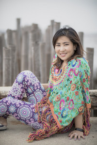 asian younger woman toothy smiling face relaxing in traveling destination