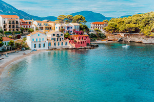 Assos village. Beautiful view to vivid colorful houses near blue turquoise colored transparent bay lagoon. Kefalonia, Greece
