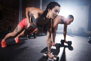 Athletes lifting weights and doing push ups
