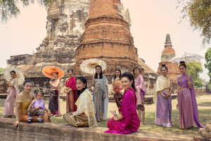 AYUTTHAYA THAILAND - MARCH 29,2018 : thai woman wearing thai tradition clothes standing wat ratchaburana ayutthaya world heritage site of unesco