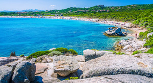 Azure beach full tourist at Porto Pollo on beautiful Sardinia island Sardinia, Italy