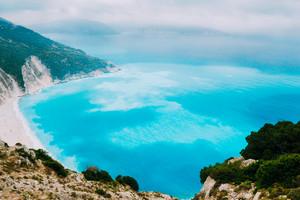 Azure water of Myrtos Beach, Kefalonia Island. Best beaches in the world and the Mediterranean, Ionian Sea