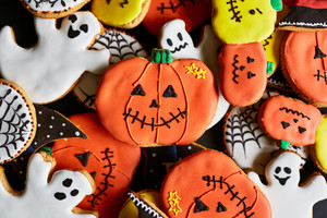 Background of halloween cookies in form of traditional symbols