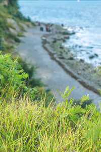 Baltic coastline. Escarpment slope lead to pebble beach. Baltic sea bay. Luebeck - Travemuende, Germany