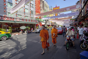 bangkok thailand - february 24,2015 : thai monk walking in yaowarat road ,yaowarat district is important thai - chinese cultural traveling place in heart of thailand capital