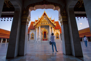 bangkok thailand - october27,2018 : tourist taking a photograph in wat benchamabophit one of most popular traveling destination in bangkok thailand