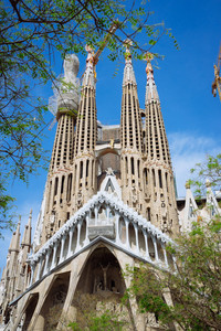 BARCELONA, SPAIN - April 25, 2018: La Sagrada Familia - the impressive cathedral designed by Gaudi, which is being build since 19 March 1882 and planed finally be done in 2026, Barcelona, Spain