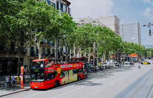 BARCELONA, SPAIN - April 26, 2018: Barcelona city tour touristic bus with tourists on the route around Barcelona, Spain