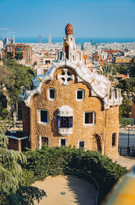 BARCELONA, SPAIN - April 26, 2018: : Ceramic mosaic Park Guell in Barcelona, Spain. Park Guell is the famous architectural town art designed by Antoni Gaudi