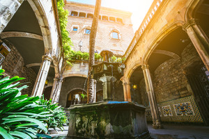 BARCELONA, SPAIN - April 26, 2018: Courtyard and fountain of Casa de l Ardiaca Archdeacon's House at night in Gothic Quarter Barri Gotic