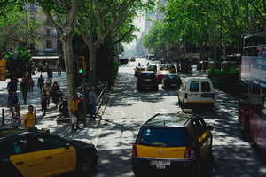BARCELONA, SPAIN. April 26, 2018: Taxi at the road junction of the historical city of Barcelona in Spain. Classic taxi yellow and black. Hybrid car