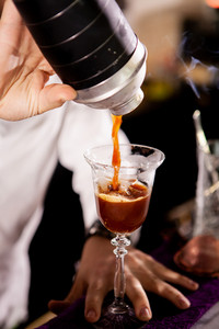 Barman making alcohol coffe drink. Pouring drink