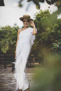 beautiful asian woman wearing white dress with straw hat toothy smiling face standing outdoor