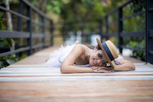 beautiful asian younger woman lying on wood path with happiness smiling face