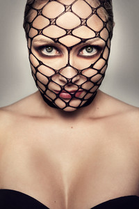 Beautiful Blonde Woman With Black Mesh On Her Face