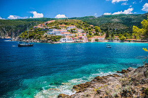 Beautiful blue bay in Assos village located on Kefalonia. Summer tourism vacation trip around Greece