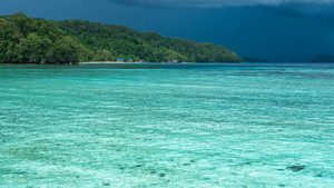 Beautiful Blue Lagoone shortly before Thunderstorm, Gam Island, West Papuan, Raja Ampat, Indonesia