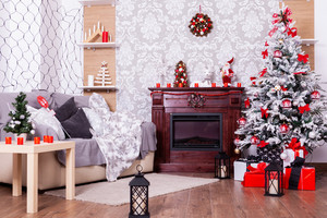 Beautiful Christmas interior with fireplace and fir tree. Happy place .