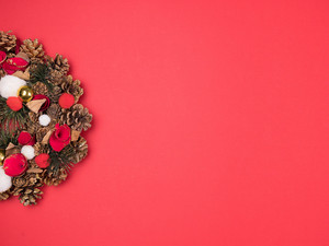 Beautiful Christmas wreath on red background. Great design