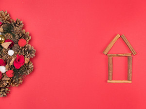 Beautiful Christmas wreath with beautiful home decoration on red background. Festive interior decor