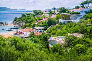 Beautiful costline with white houses and tile roofs of Porto Rafael, Palau, Sardinia, Italy