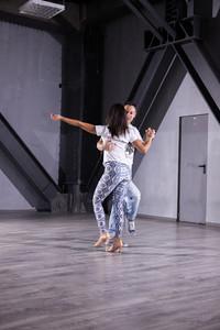 Beautiful couple dancing kizomba on class dancing room. Passion and dedication .