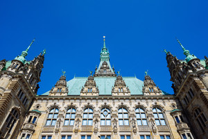 Beautiful famous Hamburg town hall building with green colored roof in Altstadt quarter, Hamburg, Germany