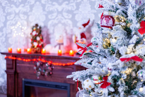 Beautiful fireplace with christmas tree near him. December mood.