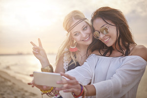 Beautiful girls taking selfie together