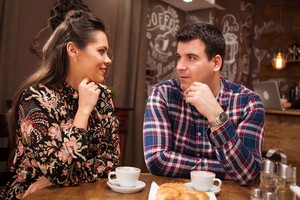 Beautiful inlove couple on a date in vintage pub or coffee shop