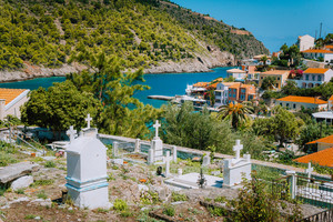 Beautiful landscape with old cemetery near picturesque town Assos, Kefalonia, Greece. Stunning amazing charming places, famous town